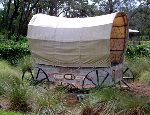 Wagon in front of settlement trading post 2
